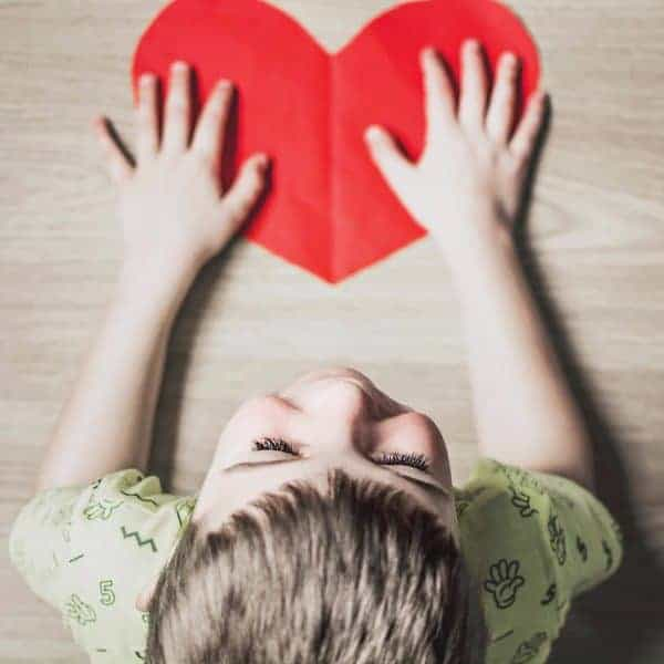Child at Desk with Heart